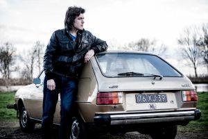 Me and my '78 Mazda 323 FA4 (that I used to own) by BlackLeatheredOokami