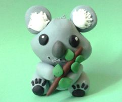 Koala with a Branch by fractalbeauty25
