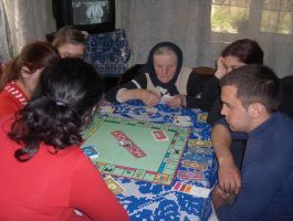 Grandmother Playing Monopoly by SDolha