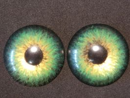 Green and gold painted eyes by DreamVisionCreations