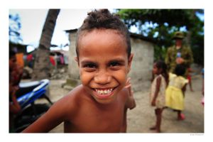 Young boy grinning. Dili, Timor-Leste. by nearthepark