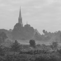 Misty landscape with a church by RafalBigda