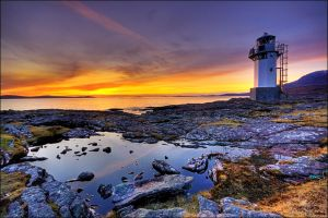Sunset over Rhue Lighhouse by ketscha