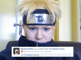 Naruto reading Sasuke's Facebook status. by TessaCrownster
