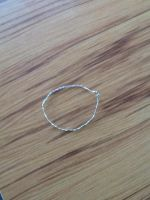 Hand-braided wire bracelet by Morninglight2