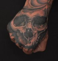 skull on hand by Robert-Franke