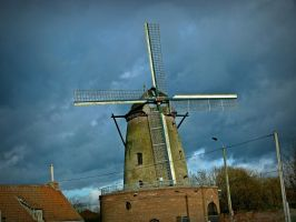 windmill and overcast sky by April-Mo
