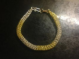 Gold and silver bracelet by Taffy-art