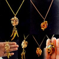 Dragon teeth and Amber Dragon necklaces by LittleCLUUs