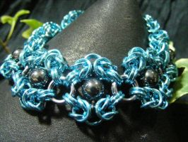 bright blue and hematite romanov bracelet by BacktoEarthCreations