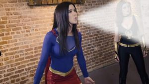 A petite Supergirl shows her superlung power by Superbreath