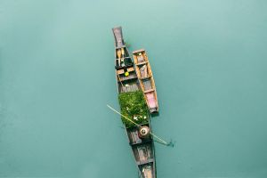 A small boat is roaming on the river by LilyBang