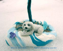 Close up of blue tailed dog sculpture by HollieBollie