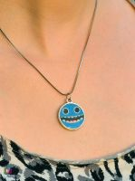 blue smiley creature necklace by Darkween