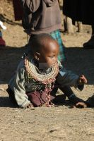 Masai child playing with dirt by Tenbult