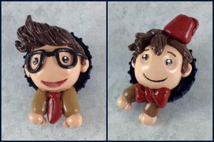 10th and 11th Doctor Pop-Out Buttons by LeiliaClay