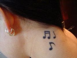 musical notes tattoo by DesignTheSkinYourIn
