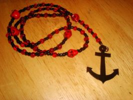black and red skull rosary by pnuewave