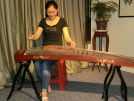 Woman playing the Zheng by Laura-in-china