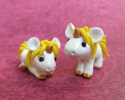 Yellow Baby Unicorns by DragonsAndBeasties