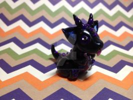Purple and Black Baby Dragon by xlightangelwolfx