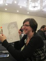 Bethany Surber holding Quick Drawing by Poorartman
