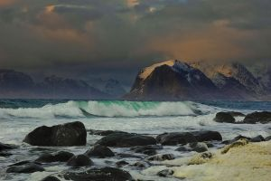 Waves against sunset by steinliland