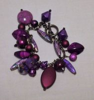 purple charm bracelet by ACrowsCollection