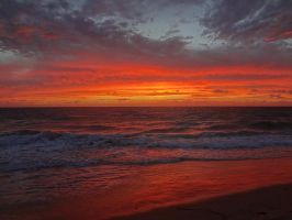 Orange Sky and Waves by Zhaanman