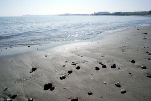 Pebbled Beach by Emz-Photography