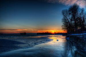 Sunset over the river by alexrkv