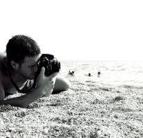 Nick shooting at the beach by NickKoutoulas