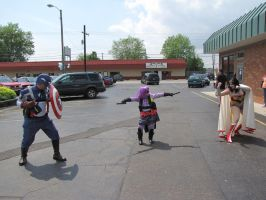 Wonder Woman and Captain America vs. Hit Girl by Wiccanslyr