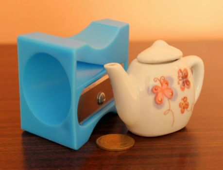 Miniature teapot and giant sharpener by Maleiva