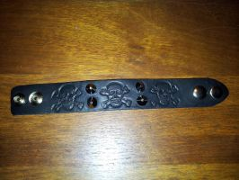 Small leather skull wrist band - open by siegeandspike