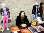 Me at my artist alley table at Nekocon 14 by BishonenHouse
