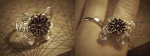 Silver flower ring by StaticSkies