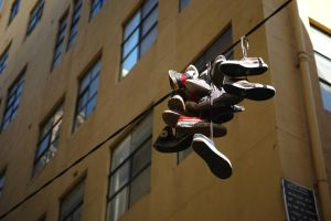 tossed shoes in Hosier Lane by thespook