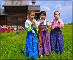 Girls playing with dandelions by Sulde