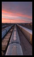 Trains into the Sunset by wyorev