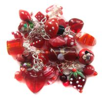 Red charm bracelet 2 by fairy-cakes