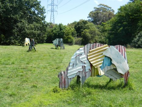 Tin cows by EcclecticRed