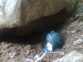 L sitting beside a tiny cave by Snappedragon