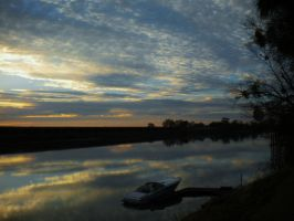 Lonely Boat Friendly Clouds by Marilyn958
