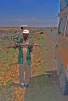 Pointing with Gun,  Ethiopia by Jenvanw
