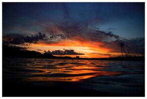 sunset on the water by eythan