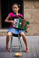 accordionist girl by emregurten