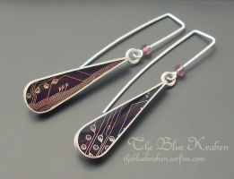silver tear drop earrings by thebluekraken