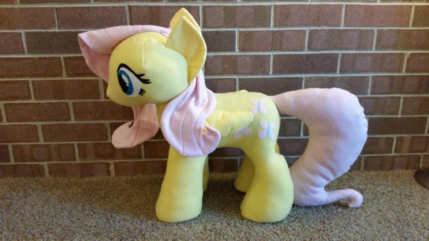 Giant stuffed riding fluttershy by RighteousBabet
