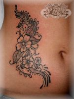 Flowers on ribs by state-of-art-tattoo